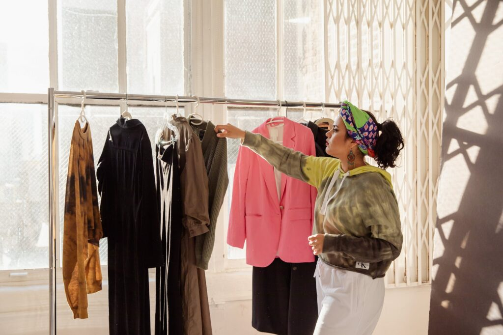 woman looking at clothes on clothing rack